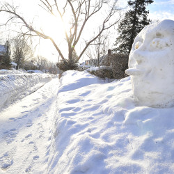 A snow sculpture at the corner of Mitchell and Hillside in South Portland reflects its neighbors' opinions of the winter weather as the sun rises on March 2, 2015, after yet another overnight snowfall.