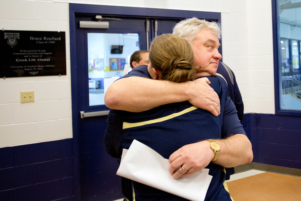 The University of Southern Maine women's basketball coach, Gary Fifield, hugs his assistant coach, Rachele Burns, after announcing his retirement at a news conference Tuesday.