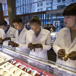 Students from Tourneau's watchmaker program in New York reset watches at the Tourneau store on Madison Avenue on Nov. 1 as Daylight Saving Time wound down in 2014. Clocks in most of the United States will need to be reset again this weekend as Daylight Saving Time begins Sunday at 2 a.m.
