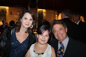 Mary Allen Lindemann and Alan Spear, owners of Coffee By Design and recipients of the Red Buoy Award in 2014, with their daughter Alina.