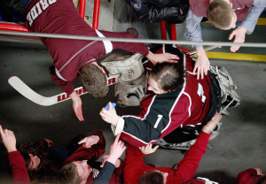 MARCH 4 FINAL: Gorham goalie Noah Bird is congratulated by fans as he leaves the ice after Gorham won the Western Class B boys' hockey championship, moving on to Saturday's state championship game against Messalonskee.
