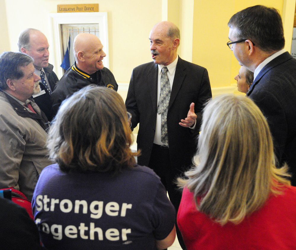 A group of labor union supporters chats with Sen. Earle McCormick, R-West Gardiner, during the annual Maine AFL-CIO Labor Lobby Day on Thursday at the State House in Augusta on Thursday.