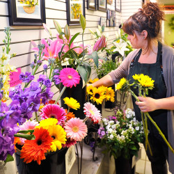 Arroyo selects a few larger flowers to add to an arrangement of flowers she is working on.