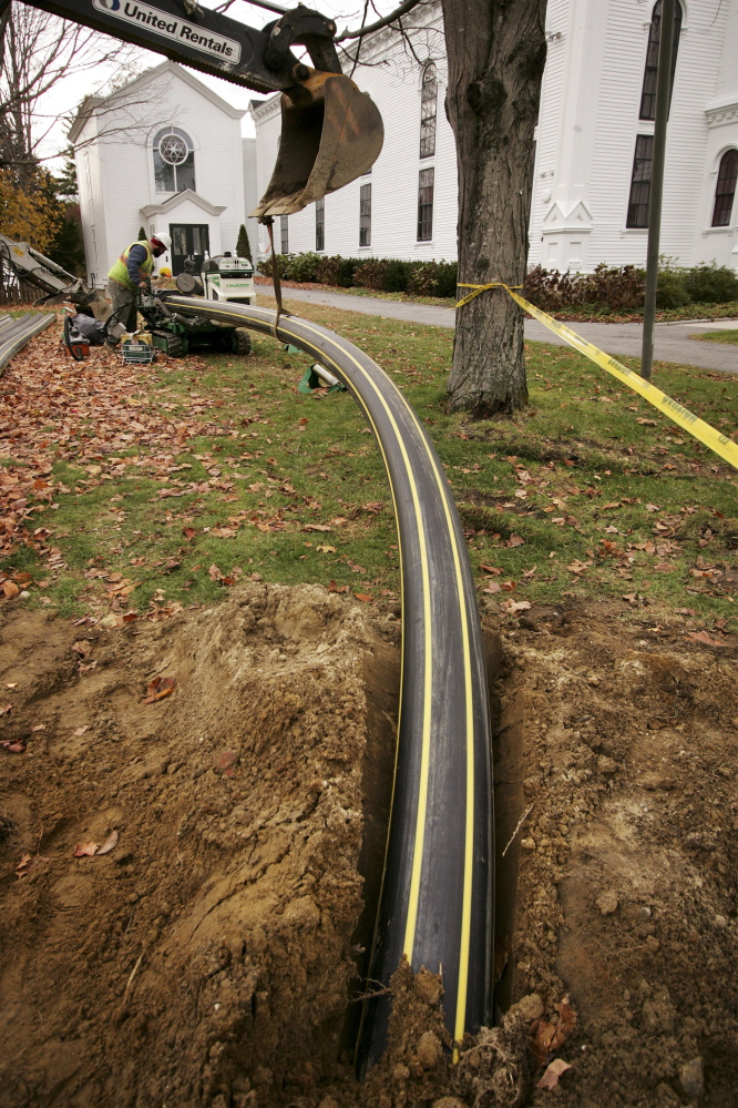 Crews from Summit Natural Gas are expected resume construction of its distribution system in the northern Portland suburbs and Augusta in April. Delays caused the company to default on its pledge to have many homes hooked up by the end of 2014. Company officials have said they used the winter to improve their planning and scheduling process to ensure they meet new deadlines. Above, an 8-inch natural gas pipe is buried along Main Street in Yarmouth in November. 2014 Telegram File Photo/Carl D. Walsh