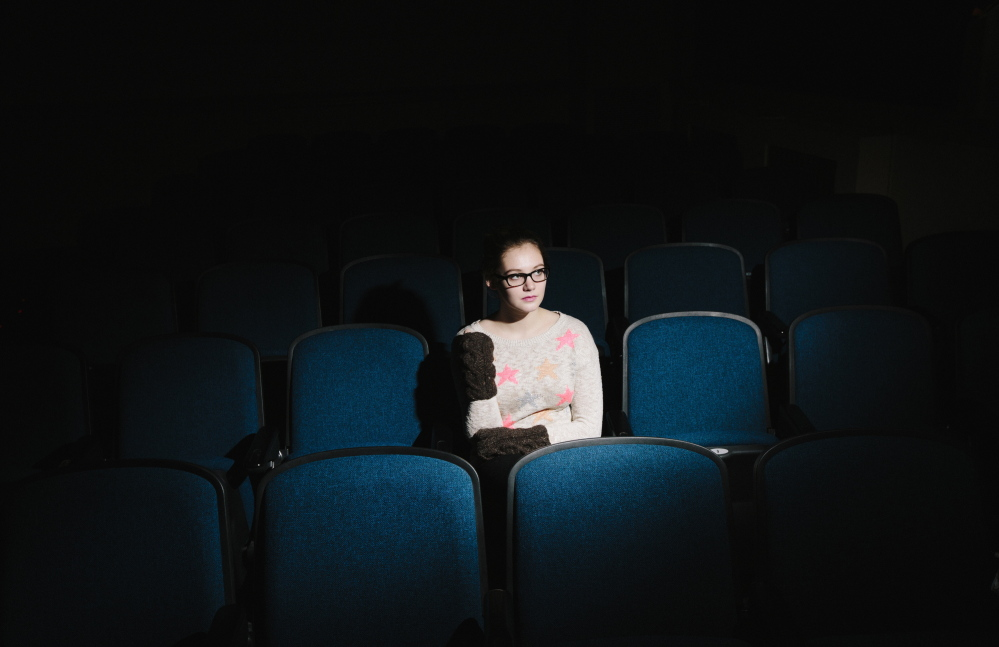 """Morgan Quigg in the auditorium at Morse High School in Bath. Quigg's original play, """"Look Up,"""" will be the Morse theater team's entry in the Maine Drama Festival."""