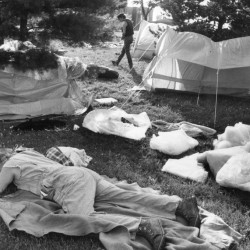 JULY 6, 1987: A man sleeps at a protest encampment in Portland's Lincoln Park, when the crisis of homelessness  and financing of the city's emergency shelters came to a head.
