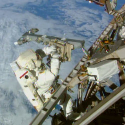 Astronaut Terry Virts installs an antenna and boom during the third spacewalk outside the International Space Station on Sunday. American astronauts Terry Virts and Butch Wilmore had 400 more feet of power and data cable, as well as two antennas, to install Sunday.