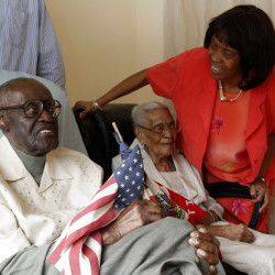 Marie Yoland Eveillard speaks with her father, Duranord Veillard ,and mother Jeanne, in Spring Valley.  Duranord Veillard celebrates his 108th birthday on Saturday and his wife, Jeanne, will turn 105 in May. The Veillards have been married 82 years and are one of the oldest married couples in New York.