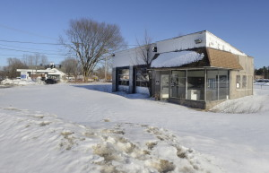 Officials have a plan to replace this old gas station at 109 Main St. in Gorham.  John Patriquin/Staff Photographer