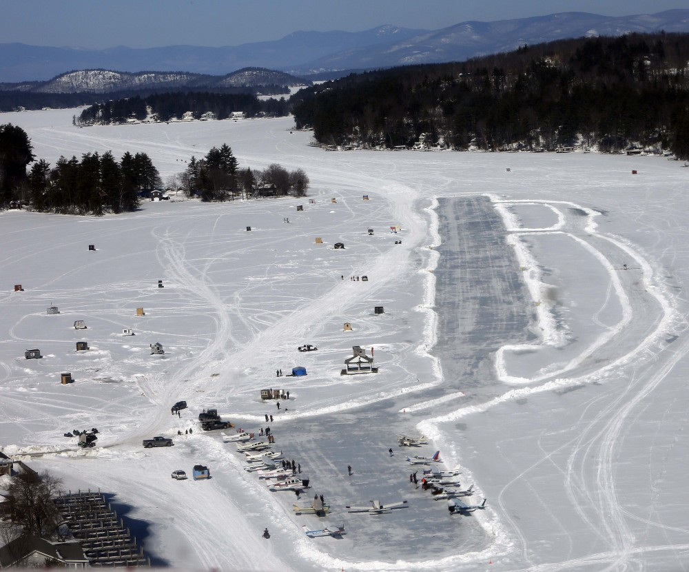 Planes sit parked on frozen Lake Winnipesaukee on Saturday. The lake is a popular winter destination for pilots.