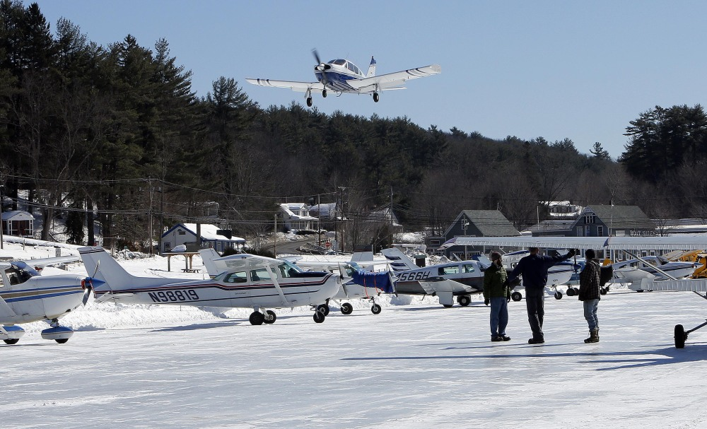 A plane flies onto the ice runway on New Hampshire's Lake Winnipesaukee on Saturday.