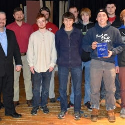 Wells High School is the state winner of this year's Samsung Solve for Tomorrow contest for its innovative class on hydrofoil technology. Pictured are, front row from left, William Dawe of Samsung and class participants Erskine Lothrop, Nathan Ouellette, Daniel Charpentier and Zachary Pierce; and, back row from left, Ryan Marsh, Chrys Demos, Jason Hludik, Gavin Turnbull, Jacob Wilson, Kyle Goodale and David Jacobs.