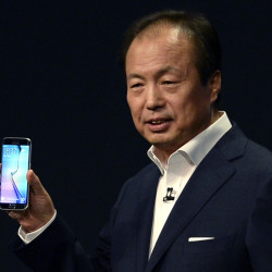 JK Shin, CEO of Samsung's mobile division, shows the new Galaxy S6 during the Samsung Galaxy Unpacked 2015 event on the eve of this week's Mobile World Congress wireless show, in Barcelona, Spain, Sunday.