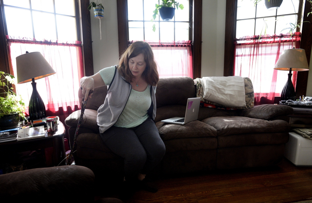 Lisa Lawlor of Saco, 43, had to find a doctor in New Hampshire after no physicians in Maine would treat her Lyme disease with long-term antibiotics. Before the treatment she could barely walk, but now she just uses a cane and lives close to a normal life.