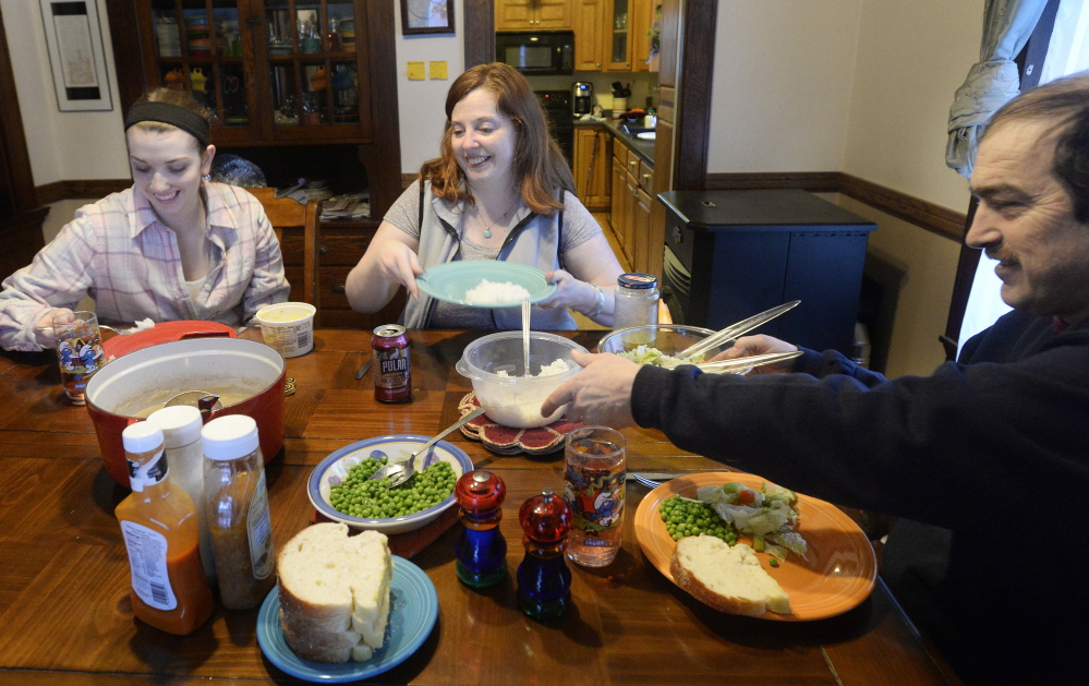 """Lisa Lawlor has a meal with her daughter, Madison, left, and husband, David. Madison says she's happy about her mother's recovery from Lyme disease: """"She used to be very outgoing and outspoken, and she's getting that back now. We're happy the medications worked."""""""