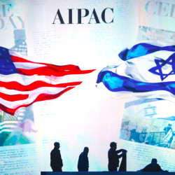 Stage hands prepare the stage for the 2015  American Israel Public Affairs Committee (AIPAC) Policy Conference in Washington, Monday.