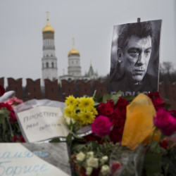 "Flowers and a condolence message that reads ""In memory of Boris"" are placed with a portrait of Boris Nemtsov, a charismatic Russian opposition leader and sharp critic of President Vladimir Putin, at the site where Nemtsov was gunned down near the Kremlin, against a backdrop of the Kremlin Wall, in Moscow, Russia, Monday."