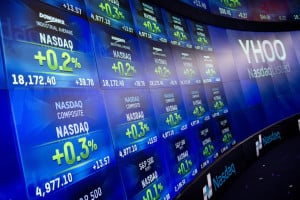 Electronic screens reflect the value of the Nasdaq Composite at the Nasdaq MarketSite on Monday in New York.