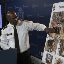 Toronto's Deputy Police Chief Mark Saunders explains evidence photos as he speaks to the media last week about a tunnel found near one of the venues for this year's Pan Am Games.