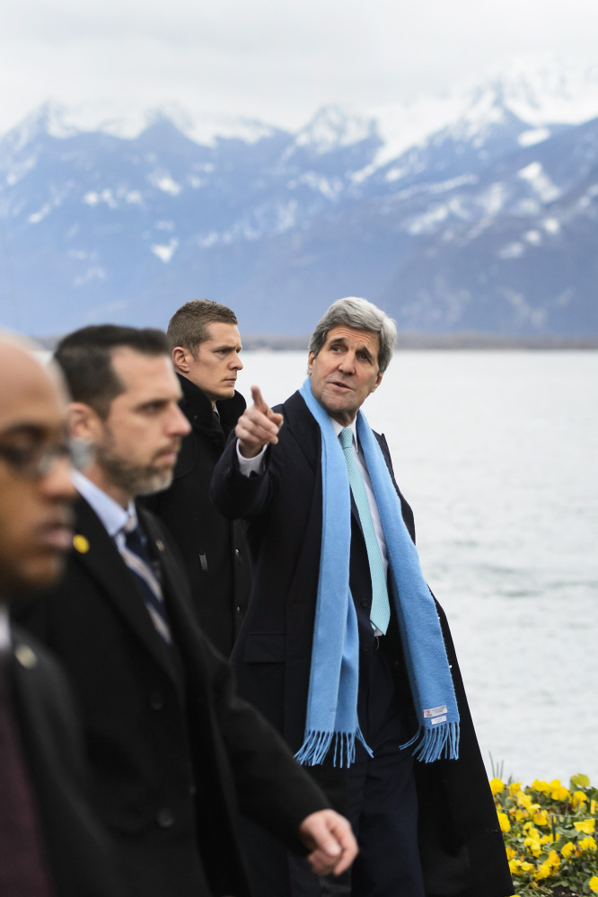 Secretary of State John Kerry walks on the bank of Lake Geneva before meeting with Iranian Foreign Minister Mohammed Javad Zarif for a new round of nuclear talks in Montreux, Switzerland, on Monday.