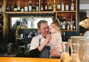 """Brian Hill with daughter Piper at Francine Bistro in Camden, one of his two restaurants. He has no plans for a third – """"Two restaurants and a baby are enough,"""" Hill says."""