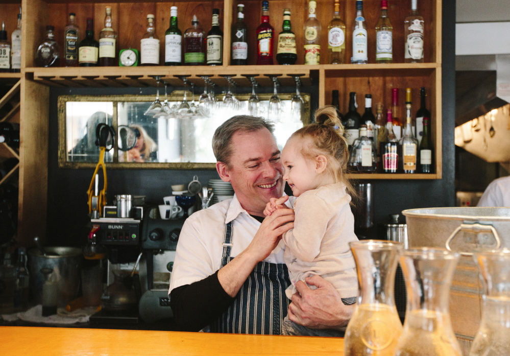"Brian Hill with daughter Piper at Francine Bistro in Camden, one of his two restaurants. He has no plans for a third – ""Two restaurants and a baby are enough,"" Hill says."