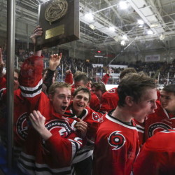 MARCH 3 FINAL: Scarborough's Sean McGovern celebrates with his teammates after the Red Storm beat Cheverus 5-2 to win the Western A regional title Tuesday at the Androscoggin Bank Colisee.