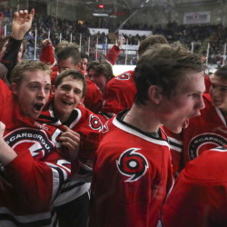 Scarborough's Sean McGovern celebrates with his teammates after the Red Storm beat Cheverus 5-2 to win the Western A regional title Tuesday at the Androscoggin Bank Colisee.