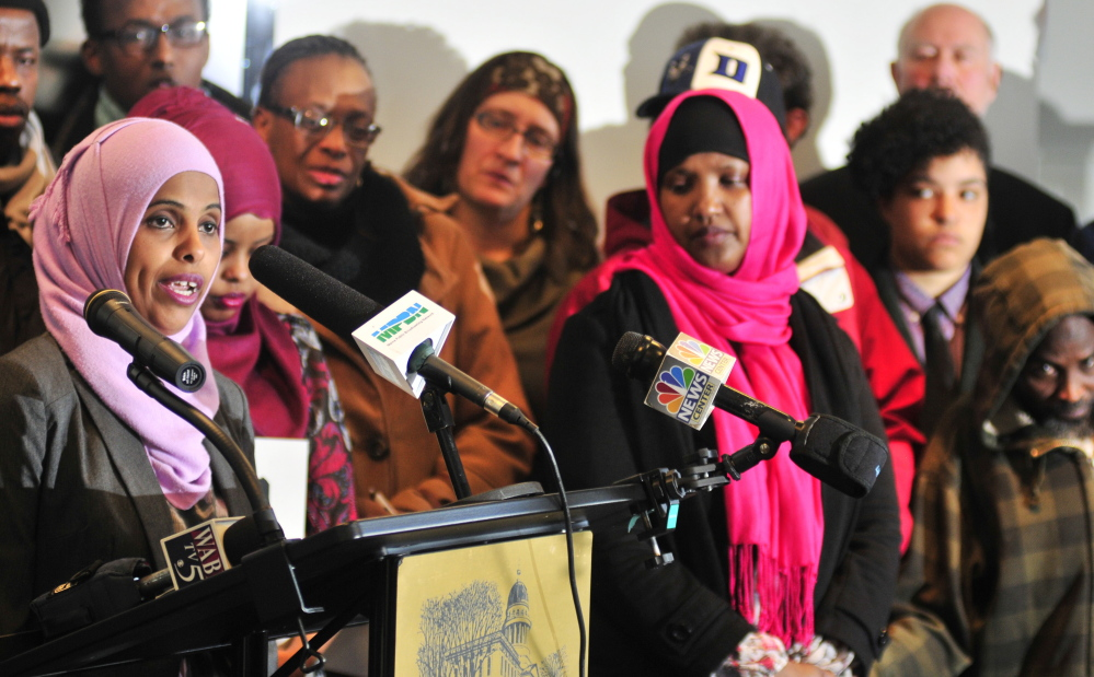 Mouna Ismail, left, of the United Somali Women of Maine, expresses her opposition at a news conference Tuesday before a hearing on Gov. Paul LePage's proposals to change the General Assistance program.