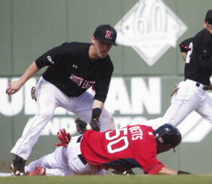 Mookie Betts of the Boston Red Sox is tagged out by Northeastern second baseman Keith Kelly while trying to steal Tuesday during Boston's 2-1 victory.