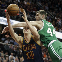 The Celtics' Tyler Zeller fouls Cleveland's Timofey Mozgov in the first quarter of Tuesday night's game in Cleveland. Boston lost by 31 points, its largest margin of this season. The Associated Press