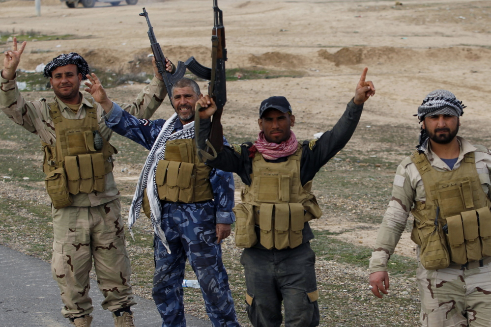 Members of the Iraqi security forces and Shiite fighters celebrate Tuesday after taking control of the town of Hamrin from Islamist State militants, in the Salahuddin province. But the battles for Tikrit and Mosul could morph into an urban war of attrition with many more casualties.