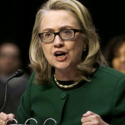 Then-Secretary of State Hillary Rodham Clinton testifies on Capitol Hill in Washington in 2013 about the deadly attack on American diplomats in Libya. Her emails from that period are only now becoming available to investigators.