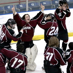 Gorham goalie Noah Bird celebrates with his teammates Wednesday night after beating Kennebunk 5-4 in the Western Class B boys' hockey final at Lewiston.