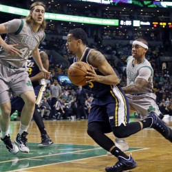 Utah Jazz guard Trey Burke drives for the hoop against Celtics guard Isaiah Thomas, right, and Celtics center Kelly Olynyk during the first half of Wednesday night's game in Boston.