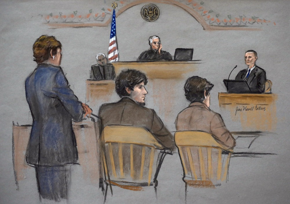 In this courtroom sketch, Bill Richard, right, is depicted testifying Thursday in the trial of Dzhokhar Tsarnaev. Tsarnaev, depicted sitting between defense attorneys Judy Clarke, left, and Miriam Conrad, second from right, is charged with conspiring with his brother to place two bombs near the Boston Marathon finish line in April 2013, killing three spectators including Bill Richard's son Martin.