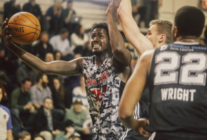 Red Claws forward Omari Johnson goes for a layup as Spurs forward Erik Murphy, center, and forward Keith Wright defend at the Expo on Thursday. Whitney Hayward/Staff Photographer