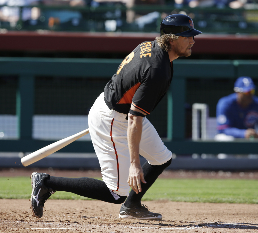 The Giants' Hunter Pence grounds out during a spring training game against the Cubs on Thursday. Pence was hit by a pitch later in the game and sustained a broken forearm.