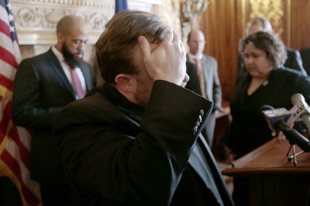 After more than 24 hours of debate, Wisconsin Rep. Cory Mason, D-Racine, wipes his face at the end of a news conference following passage of right-to-work legislation in the Assembly at the State Capitol in Madison, Wis., on Friday.