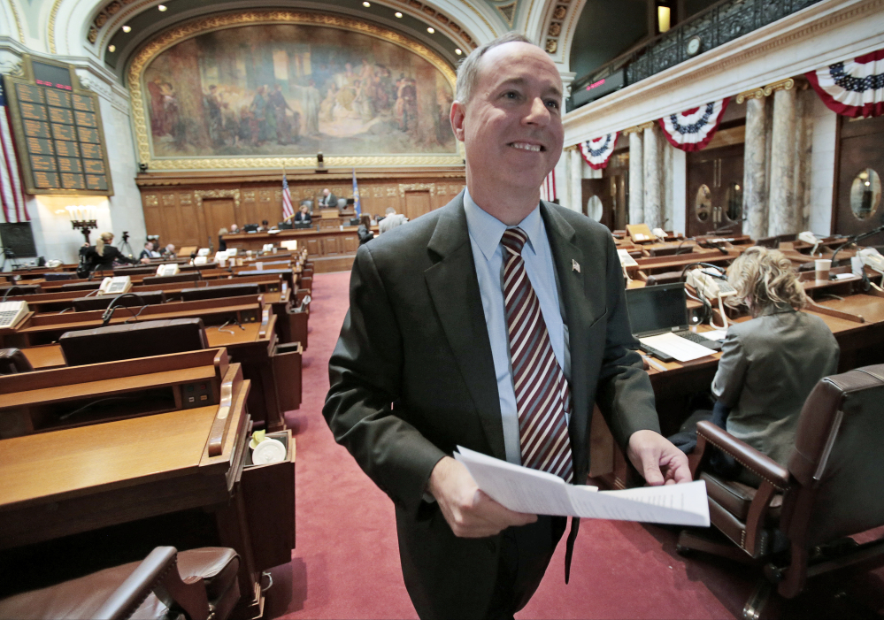 Wisconsin Assembly Speaker Robin Vos, R-Rochester, walks off the floor after passage of right-to-work legislation in the Assembly at the State Capitol in Madison, Wis., on Friday.