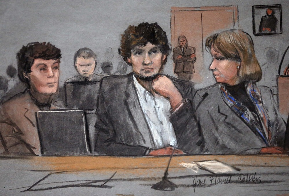 In this courtroom sketch, Dzhokhar Tsarnaev is depicted between defense attorneys Miriam Conrad, left, and Judy Clarke, right, during his federal death penalty trial Thursday in Boston. Tsarnaev is charged with conspiring with his brother to place two bombs near the Boston Marathon finish line in April 2013, killing three and injuring 260 people.