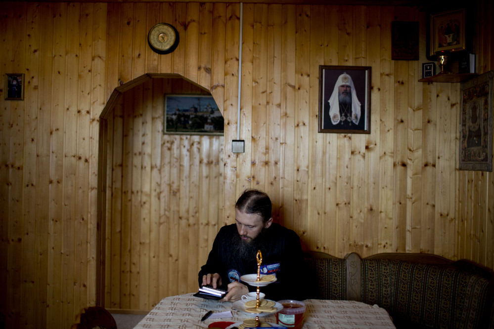 """Sophrony Kirilov says there is no place he feels closer to God than in this frigid land. """"Here, you can calmly pray to God in peace and quiet. Sure, you can do it anywhere in Russia, but here, it's special,"""" the priest said. The Associated Press"""