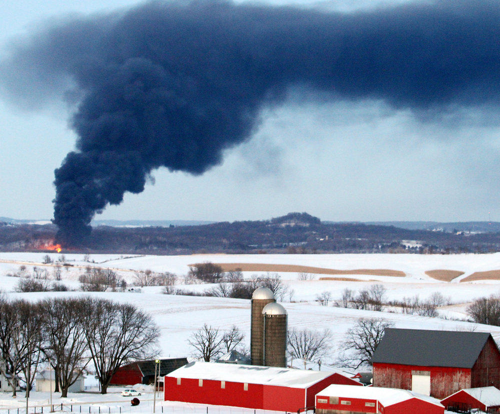 Smoke rises from a train derailment near Galena, Ill. Twenty-one modernized oil cars derailed and sparked a fire near Galena on Thursday.