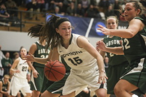 Bowdoin guard Marle Curle is surrounded by Babson defenders as she looks for an open teammate Friday during a first-round game of the NCAA Division III women's basketball tournament in Brunswick. Curle scored 16 points as the Polar Bears advanced with a 70-57 win.