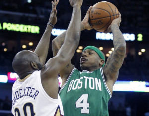 Celtics guard Isaiah Thomas shoots over New Orleans guard Quincy Pondexter in the second half of Friday night's game in New Orleans. The Celtics defeated the Pelicans, 104-98.