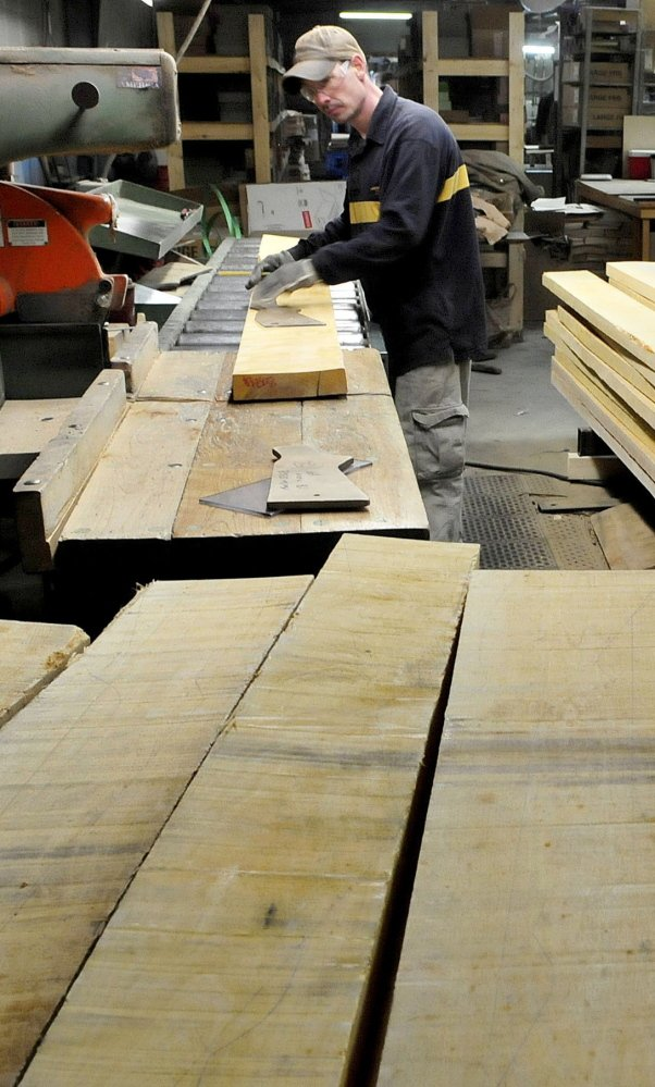 Mike Pelletier works at the thriving Cousineau Wood Products in North Anson.