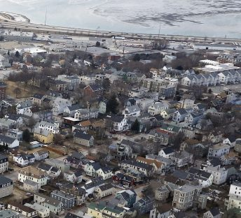 "An aerial view of Munjoy Hill/Eastern Prom area. A spokeswoman for the Munjoy Hill Neighborhood Organization says the number of short-term rentals in the area being advertised on Airbnb is ""quite astounding"" as property owners realize they can make better money renting their units to tourists, rather than residents."