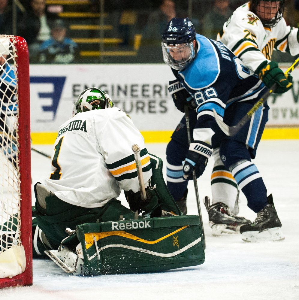 Maine's Blaine Byron looks for a rebound in front of Vermont goalie Mike Santaguida during Game 3 of a Hockey East playoff series in March. He and Nolan Vesey return to the Black Bears this year as the top goal-scorers from last winter.