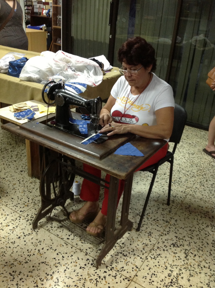 In Havana, a woman makes yarmulkes for sale at Adath Israel, the only Orthodox Jewish synagogue remaining in Cuba.