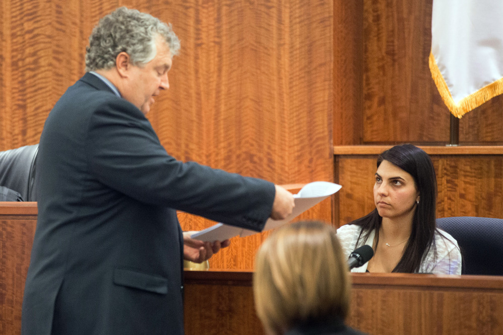 Defense attorney Michael Fee questions babysitter Jennifer Fortier during the murder trial of former New England Patriots football player Aaron Hernandez at Bristol County Superior Court on Monday in Fall River, Mass.